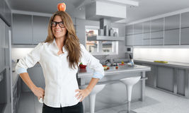 Woman with apple in the kitchen Stock Image