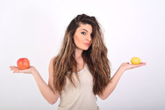 Woman with apple and lemon Royalty Free Stock Photos