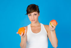 Woman with apple and orange Stock Photography