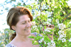 A woman in  apple orchard at  early spring Royalty Free Stock Photos