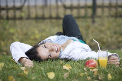 Woman with apple at the park Royalty Free Stock Photos