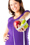 Woman with apple, pear and measuring tape Royalty Free Stock Photography