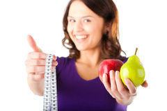 Woman with apple, pear and measuring tape Stock Photography