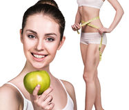 Woman with apple and perfect body Stock Photography