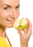 Woman with apple slice Royalty Free Stock Photos