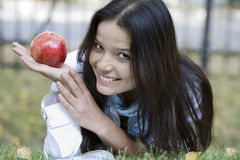 Woman with apple at the summer park Royalty Free Stock Images