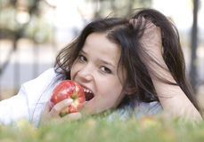 Woman with apple at the summer park Stock Image