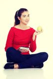 Woman with apple and tablet computer. Royalty Free Stock Photos