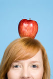 Woman with an apple on top of her head Stock Photo