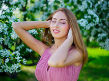Woman with apple tree Stock Photo