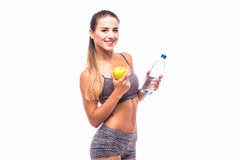 Woman with apple and water smiling with cheerful confidence isolated on white Stock Photo
