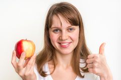 Woman with apple  on white - healthy diet concept Stock Images