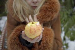 Woman With Apple In Winter Royalty Free Stock Photos