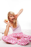 Woman with apple yawning Royalty Free Stock Photo