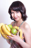 Woman with apples and bananas Royalty Free Stock Image
