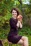 Woman with apples in the hands in autumn park Stock Image