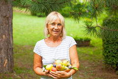 Woman with apples and pears Stock Photo