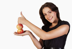 Woman with apples in studio showing hand ok Royalty Free Stock Image