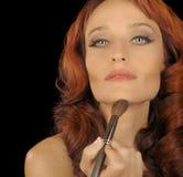 Woman applies Makeup Royalty Free Stock Images