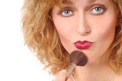 Woman applies Makeup Royalty Free Stock Image