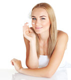 Woman apply anti wrinkle cream Royalty Free Stock Image