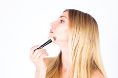 Woman apply foundation on the face tone Stock Image