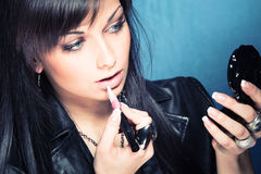 Woman apply lipgloss Royalty Free Stock Images