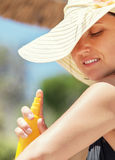 Woman apply suntan lotion Royalty Free Stock Photography