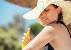 Woman apply suntan lotion Royalty Free Stock Image