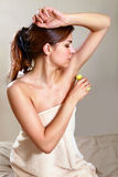 Woman applying antiperspirant Stock Image