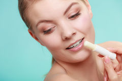 Woman applying balsam for lips Royalty Free Stock Images
