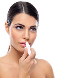 Woman Applying Balsam On Lips Stock Images