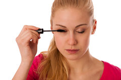 Woman applying black mascara on eyelashes, doing makeup. Stock Photography
