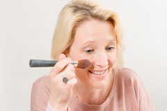 Woman Applying Blush Royalty Free Stock Image