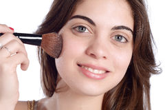 Woman applying blush. Stock Image