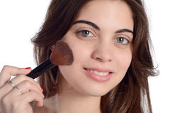 Woman applying blush. Close up of a young beautiful woman applying blush Stock Photos