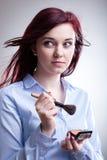Woman applying blush Stock Photos