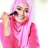Woman applying blush on Stock Photography