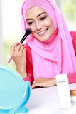 Woman applying blush on Royalty Free Stock Images