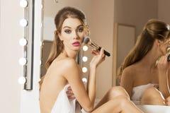 Woman applying blush Stock Photography