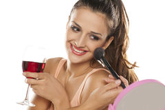 Woman applying blush Stock Photo