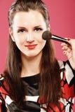 Woman applying blusher Royalty Free Stock Photos