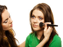 Woman applying blusher Royalty Free Stock Photo