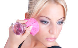Woman applying blusher container Stock Photography