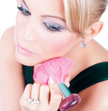 Woman applying blusher container with pink brush Stock Image