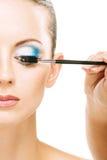 Woman applying blusher eyelid Royalty Free Stock Image