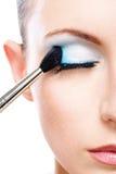 Woman applying blusher eyelid Royalty Free Stock Photos