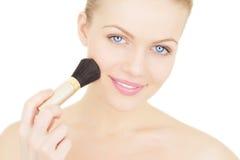 Woman applying blusher isolated Stock Image