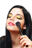 Woman applying blusher Royalty Free Stock Images