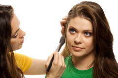 Woman applying blusher Royalty Free Stock Images